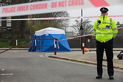 © Licensed to London News Pictures. 02/04/2019. London, UK. A police tent at the crime scene on Grafton Road, junction with Vicars Road in Kentish Town, north west London where a man in his 20s was found stabbed around 8.30pm on Monday 1 April 2019. He was pronounced dead at the scene. Photo credit: Dinendra Haria/LNP
