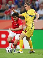 v.l. Raphael Wicky, Andriy Vorobey Ukraine<br /> Fussball WM 2006 Achtelfinale Schweiz - Ukraine<br />  Sveits - Ukraina<br /> Norway only