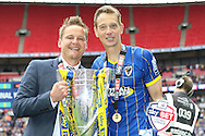 AFC Wimbledon Manager Neal Ardley with Paul Robinson defender for AFC Wimbledon (6) ( Man of the match ) & the trophy after AFC Wimbledon seal promotion to League One, after beating Plymouth Argyle Football Club 2-0 during the Sky Bet League 2 play off final match between AFC Wimbledon and Plymouth Argyle at Wembley Stadium, London, England on 30 May 2016. Photo by Stuart Butcher.