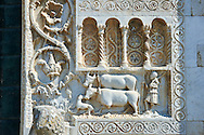 Sculpture of a man with two cows on the 12th century Romanesque facade of the Chiesa di San Pietro extra moenia (St Peters), Spoletto, Italy .<br /> <br /> Visit our MEDIEVAL PHOTO COLLECTIONS for more   photos  to download or buy as prints https://funkystock.photoshelter.com/gallery-collection/Medieval-Middle-Ages-Historic-Places-Arcaeological-Sites-Pictures-Images-of/C0000B5ZA54_WD0s