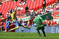 Kevin Hayes of Stockton Town (7) makes a dive for the ball as Chris Rackley of Thatcham Town (1) makes the clearance during the FA Vase match between Stockton Town and Thatcham Town at Wembley Stadium, London, England on 20 May 2018. Picture by Stephen Wright