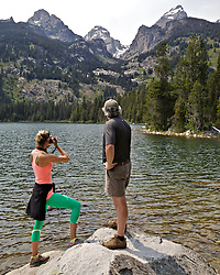 Hikers pause for a photo at Bradley Lake in Grand Teton National Park. The Teton Range has been I draw for tourism for 120 years.