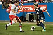 FRISCO, TX - JANUARY 31:  Megan Rapinoe #15 of the U.S. Women's National Team controls the ball against the Canadian Women's National Team on January 31, 2014 at Toyota Stadium in Frisco, Texas.  (Photo by Cooper Neill/Getty Images) *** Local Caption *** Megan Rapinoe