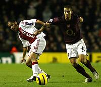 Photo: Chris Ratcliffe.<br />Arsenal v Ajax. UEFA Champions League. 07/12/2005.<br />MAtthieu Flamini of Arsenal gets away from Steven Pienaar