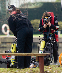 © under license to London News Pictures.  03/01/2011. A police search dive team look for the bodies of two men feared dead after six people fell from a boat into the river Thames at Shepperton yesterday evening. Photo credit should read: London News Pictures.