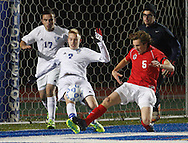 Isaiah Gowen (7) of Lake George kicks the ball away from the goal before Harrison Seideman (5) of Friends Academy can take a shot during a Class C state semifinal game at Faller Field in Middletown on Saturday, Nov. 16, 2013. (Tom Bushey – Special to The Post-Star)