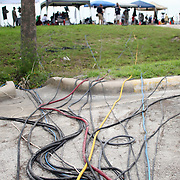 Television cables line the parking lot at the media press site at the Kennedy Space Center Friday, July 8, 2011, in Cape Canaveral, Fla. Over 1500 members of the press were credentialed to view the STS-135 launch on Friday. (AP Photo/Alex Menendez)