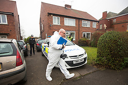 © Licensed to London News Pictures. 17/01/2017. Dinnington UK. Picture shows police forensic officer's at a house close to the scene in Dinnington where the body of Leonne Weeks was found of Lordens Hill. Police have arrested an 18 year old man on suspicion of murder. Police have said they have concerns around the state of the body & the injuries & are treating her death as suspicious. Photo credit: Andrew McCaren/LNP