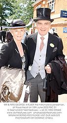 MR & MRS GEORGE WALKER the millionaire buisnessman, at Royal Ascot on 18th June 2002.PBC 51