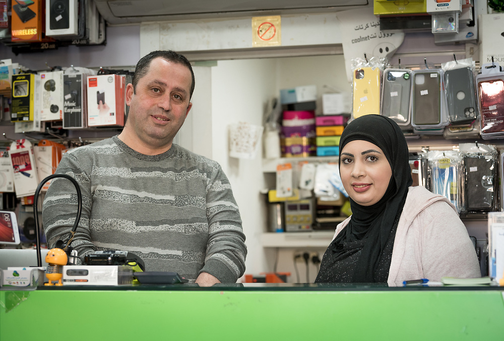 27 February 2020, Ramallah, Palestine: Na'el Shareef (left) runs a small phone shop in Ramallah. Here, with 29-year-old Jihad Albaba, from the Am'ari Camp, who works in the shop, since graduating from studies in Telecommunication at the Lutheran World Federation vocational training centre in Ramallah.