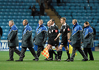 Photo: Ed Godden.<br />Coventry City v Sheffield Wednesday. Coca Cola Championship. 18/11/2006. The Match officials leave the pitch at full time.