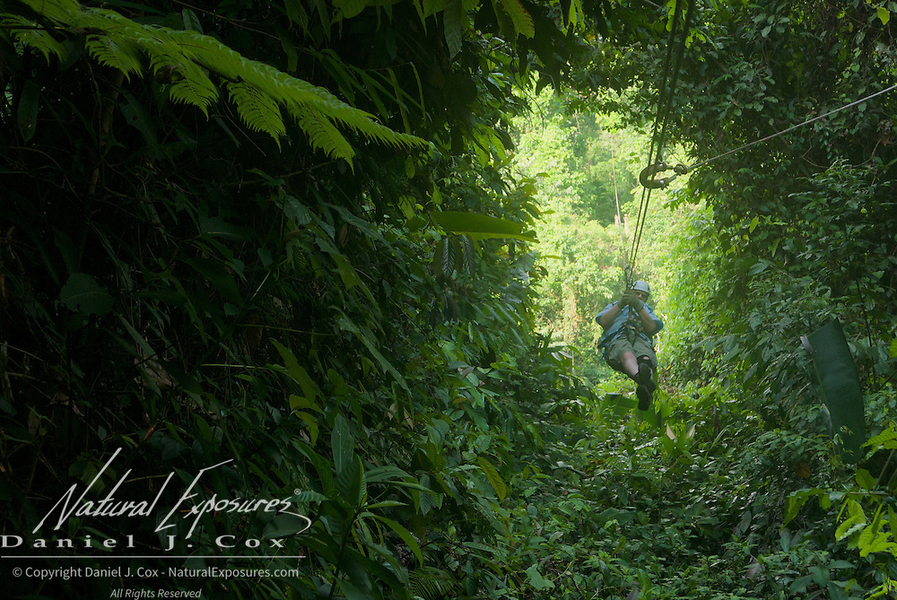Paul coming through a gap in the forest canopy on the zip line. Costa Rica.