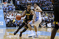 01 December 2015: Maryland's Melo Trimble (2) and North Carolina's Marcus Paige (right). The University of North Carolina Tar Heels hosted the University of Maryland Terrapins at the Dean E. Smith Center in Chapel Hill, North Carolina in a 2015-16 NCAA Division I Men's Basketball game. UNC won the game 89-81.