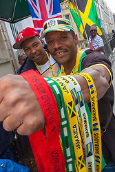 London, August 24th 2014. A man sells whistles as revellers prepare to participate in 2014's Notting Hill Carnival in London, celebratingWest Indian and other cultures, and attracting hundreds of thousands to Europe's biggest street party.