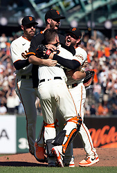Oct 3, 2021; San Francisco, California, USA; San Francisco Giants players celebrate their 11-4 victory over the San Diego Padres at Oracle Park. Mandatory Credit: D. Ross Cameron-USA TODAY Sports
