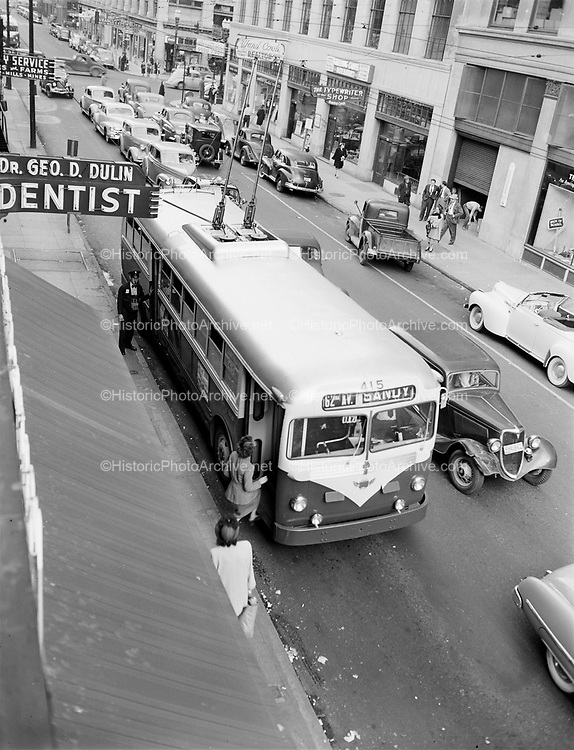 Y-480818A-03.  Trolley busses on SW Stark, Portland, between 4th and 5th. August 18, 1948