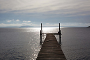 Jetty on the banks of a lake at dawn, showing vanishing point. Working Gaucho Fazenda in Rio Grande do Sul, Brazil.