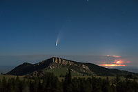 There are some things that just don't happen every day. One of the brightest comets in decades is swinging past Earth this month. As I brainstormed to figure out where to capture it, Steamboat Point seemed like an obvious choice. Anyone who has driven Highway 14 would recognize this iconic peak of the Bighorn Mountains. It gets its name because of the massive rock face that sticks into the air like the prow of a steamboat. Even though storms were around in the evening, I was not expecting them to last. But lightning flashed to the north for the entire night. The red color is an effect caused by viewing from a long distance through the thicker atmosphere. At 2:30AM, the comet rose above the northeast horizon, tail-first. A comet's tail always points away from the Sun. The 67% moon off to the right lit up the mountain, while shadows added depth to the scene. Soon after this, noctilucent clouds joined the show, but that's for another post. By the time the sun rose my memory card had 1400 new images. It was a night very much worth losing sleep over.