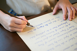 November 19, 2018 - USA - A girl uses a pen to write a letter. (Credit Image: © Kitichai Songkiettisri/Dreamstime/TNS via ZUMA Wire)