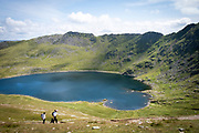 Walkes pass Red Tarn lake high up on the eastern flank of Helvellyn Mountain, English Lake District, Cumbria, United Kingdom on the 2nd of August 2021. Red Tarn is a glacial lake formed with the glacier that carved our the eastern side of the mountain melted. It is the habitat of the rare and endangered Schelly fish.(photo by Andrew Aitchison / In pictures via Getty Images)