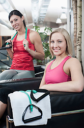 Portrait of two smiling women in a gym