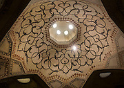 Stunning photographs reveal the beautiful ceilings in Iran's mosques, bazaars and public baths<br /> <br /> For the past few decades, restrictions on travel to Iran has meant the country has been largely shut off from the Western world, butas visa sanctions are lifted in the light of a landmark nuclear deal, the local tourism industry is hoping for a flurry of visitors.<br /> It's not hard to see why Iran is listed as one of the top travel destinations of 2016, with its rich culture and history.<br /> Among the standout aspects of the nation is its beautiful ancient architecture, with the cities and towns littered withornate and eye-catching mosques, public baths and markets.<br /> And unlike many other countries - the roof is not an afterthought, with many ceilings built as the centrepiece to the building, with many of the tile designs showcasing a display of intricate geometric patternsthatdate back several centuries.<br /> French photographerEric Lafforgue has travelled the country photographing the ceilings of indoor markets, mosques and bath houses.<br /> <br /> Photo shows: The Karim Khan Fort is a citadel located in downtown Shiraz, and inside the castle is a public bath house with this tiled ceiling