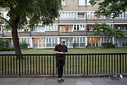 A young man uses his mobile phone on 16th June 2017 in London, United Kingdom.  From the series Our Small World, an observation of our mobile phone obsessions