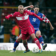 Turkey's Gokhan TORE (L) and Croatia's Tomislav DUJMOVIC (R) during their UEFA EURO 2012 Play-off for Final Tournament First leg soccer match Turkey betwen Croatia at TT Arena in Istanbul Nüovember11, 2011. Photo by TURKPIX