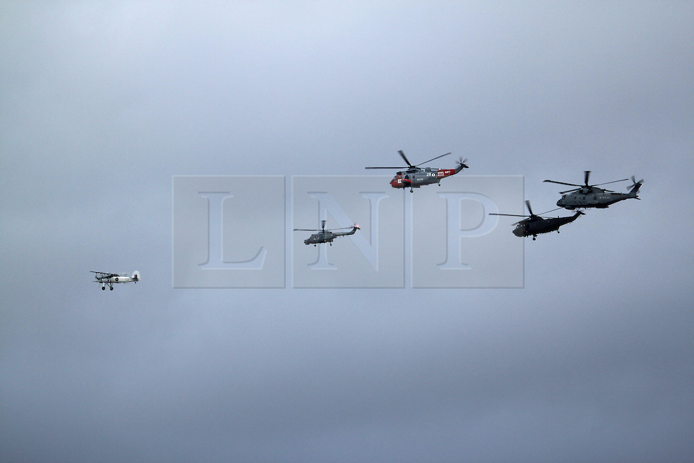 © Licensed to London News Pictures. 08/05/2013. London, UK. A Royal Navy flypast, including a Sea King and Merlin, over Greenwich as part of events to mark the 70th anniversary of the Battle of the Atlantic. The fly past was shown live on BBC1 on the One Show.. Photo credit : Rob Powell/LNP