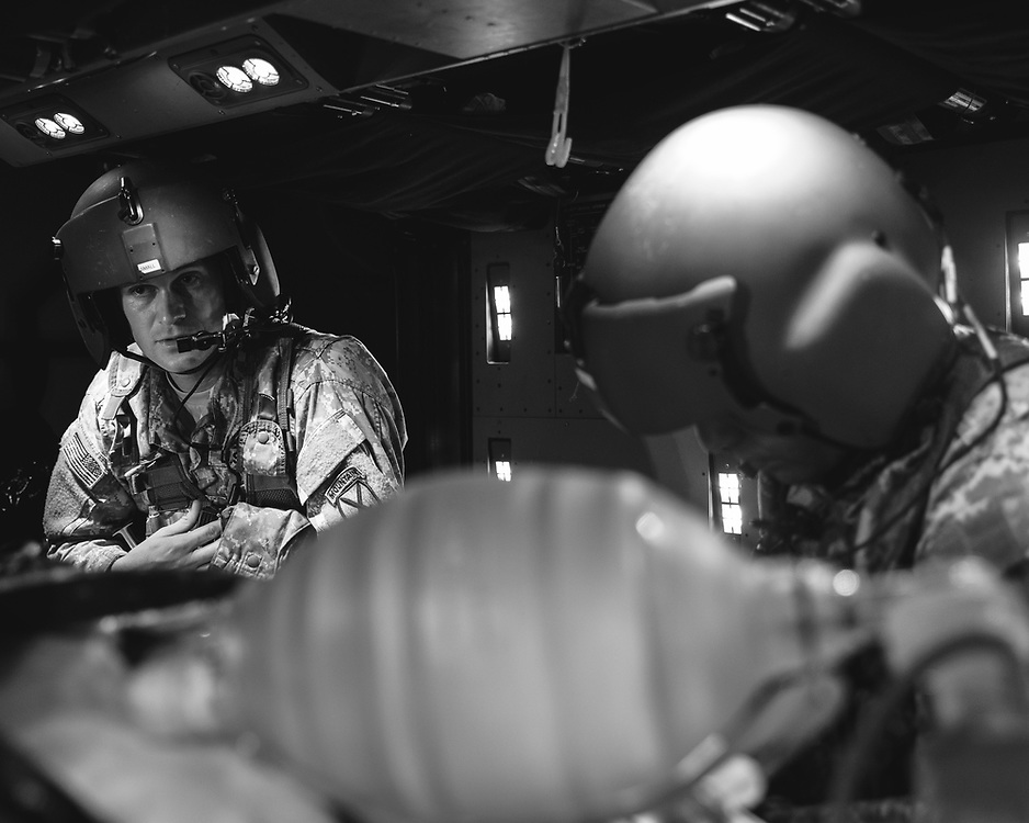 Performing critical care in the limited space of a HH-60 cabin.