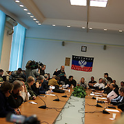 Pro-Russia activists hold a press conference at the Donbass Regional Government building in central Donetsk. The activists occupied the building over the past weekend and are now barricaded inside expecting a policial intervention as the Ukrainian government in Kiev gave a 48 hour deadline for the activists to abandon the building.