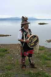 Alaska, dancer, Cruising the Southeast wilderness waterways on the Spirit of Discovery. Visit to Tlingit native village of Kake, population 800.  Photos of clothing design, jewelry, totem pole, bear, wood carver, world tallest totem pole at 132 feet, dances, male dancer (model released) and houses.Photo copyright Lee Foster, 510/549-2202, lee@fostertravel.com, www.fostertravel.com..