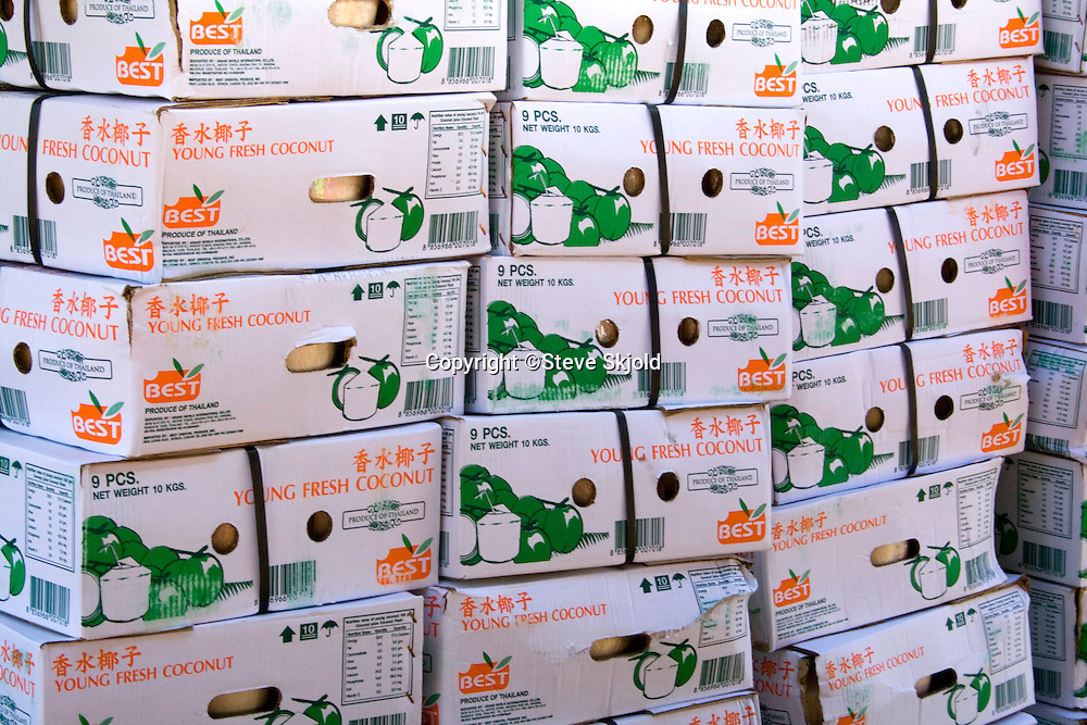 Crates of young fresh coconut for food concession stand.  Hmong Sports Festival McMurray Field St Paul Minnesota USA