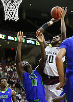 Texas A&M's Tonny Troche-Morelos (10) makes a basket over Florida Gulf Coast University's Kevin Mickle (10) during a NCAA college basketball game in College Station, Texas, Wednesday, Dec. 2, 2015.  Texas A&M won 75-65. (AP Photo/Sam Craft)