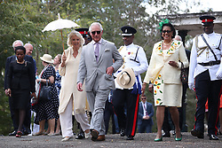 The Prince of Wales and the Duchess of Cornwall near Old Government House during a one day visit to the Caribbean island of Grenada.