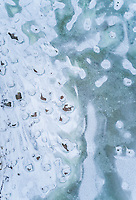 Abstract aerial view of the frozen rocky sea in Muraste, Estonia.