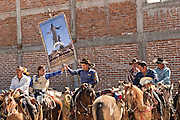 Mexican cowboys gather for Catholic mass at the San Martin de Terreros church during the annual Cabalgata de Cristo Rey pilgrimage January 4, 2017 in Guanajuato, Mexico. Thousands of Mexican cowboys and horse take part in the three-day ride to the mountaintop shrine of Cristo Rey stopping along the way at shrines and churches.
