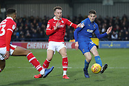 AFC Wimbledon defender Steve Seddon (15) passing the ball during the EFL Sky Bet League 1 match between AFC Wimbledon and Barnsley at the Cherry Red Records Stadium, Kingston, England on 19 January 2019.