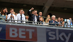 Huddersfield Town chairman Dean Hoyle celebrates in the stands