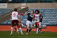 Millwall Forward Jon Dadi Bödvarsson(22)  and Bristol City Midfielder Alex Scott (36)  battles for possession during the EFL Sky Bet Championship match between Millwall and Bristol City at The Den, London, England on 1 May 2021.