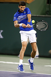 March 9, 2019 - Indian Wells, CA, U.S. - INDIAN WELLS, CA - MARCH 09: Novak Djokovic (SRB) hits a backhand during the second round of the BNP Paribas Open on March 09, 2019, at the Indian Wells Tennis Gardens in Indian Wells, CA. (Photo by Adam Davis/Icon Sportswire) (Credit Image: © Adam Davis/Icon SMI via ZUMA Press)