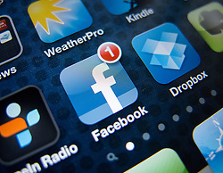 detail of iPhone 4G screen showing Facebook app