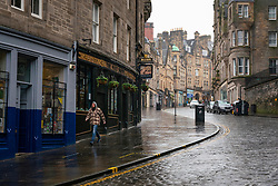 Edinburgh, Scotland, UK. 20 January 2020. Views of quiet streets in Edinburgh city centre on day after First minister Nicola Sturgeon announced national lockdown would be extended into February. Streets remain very quiet with no non essential shops open. Pic; Cockburn Street in the Old Town is almost deserted.  Iain Masterton/Alamy Live News