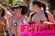 26 MARCH 2012 - PHOENIX, AZ:  CHRISTI, center, participates in a topless protest Sunday. About 40 people marched through central Phoenix Sunday to call for a constitutional amendment to give women the same right to go shirtless in public that men have. The Phoenix demonstration was a part of a national Topless Day of Protest. Phoenix prohibits women from going topless in public so protesters, women and men, covered their nipples and areolas with tape. The men did it to show solidarity with the women marchers.   PHOTO BY JACK KURTZ