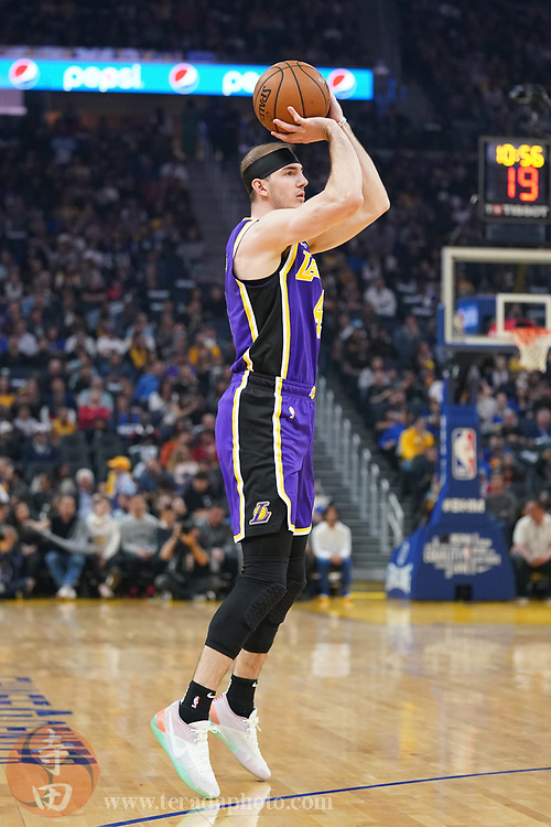 February 27, 2020; San Francisco, California, USA; Los Angeles Lakers guard Alex Caruso (4) shoots the basketball against the Golden State Warriors during the second quarter at Chase Center.