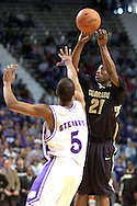 Colorado guard Marcus Hall (R) puts up a shot against Kansas State's Clent Stewart (L) during the first half of the Wildcats 72-60 win over the Buffaloes at Bramalage Coliseum in Manhattan, Kansas, February 18, 2006.