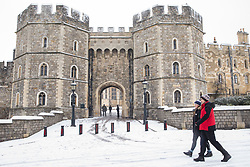 The first snowfall of winter lies outside the King Henry VIII gate to Windsor Castle on 24th January 2021 in Windsor, United Kingdom. The current spell of cold weather is expected to continue for another two or three days.
