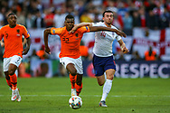 England defender Ben Chilwell (Leicester City) tussles with Netherlands defender Denzel Dumfries (22) during the UEFA Nations League semi-final match between Netherlands and England at Estadio D. Afonso Henriques, Guimaraes, Portugal on 6 June 2019.