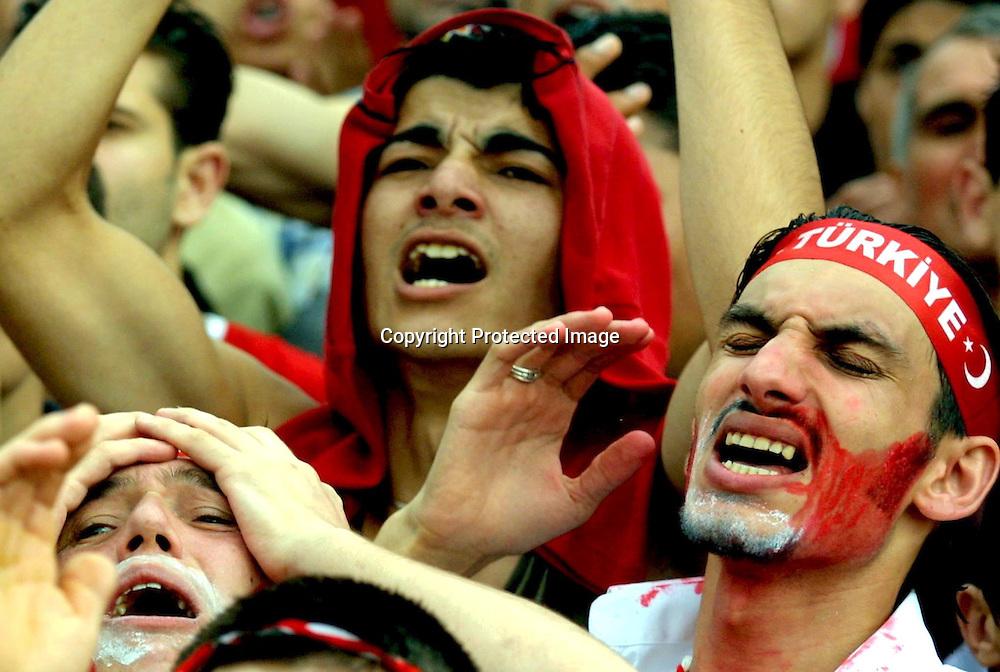 IST06 - 20020626 - ISTANBUL, TURKEY : Turkish soccer fans react to Brazilian Ronaldo's 49th-minute goal in Istanbul on Wednesday 26 June 2002 while watching on TV the 2002 World Cup semi-final Turkey vs Brazil. Turkey lost 1-0.    EPA PHOTO  EPA / KERIM OKTEN
