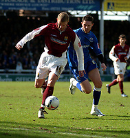 Photo: Ian Hebden.<br />Peterborough United v Northampton Town. Coca Cola League 2. 01/04/2006.<br />Northamptons Martin Smith (L) and Peterboroughs Mark Arber (R) tussle for the ball.